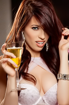Caitlin McSwain Drinking Champagne
