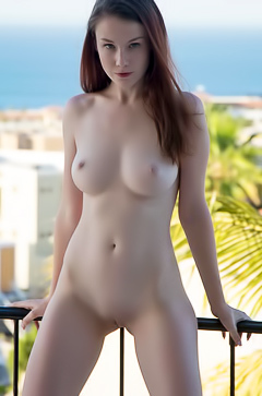 Emily flaunts her body on the balcony