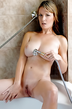 Busty babe Miriam is taking a hot sexy shower bath